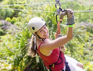 Woman going on a jungle zip line adventure